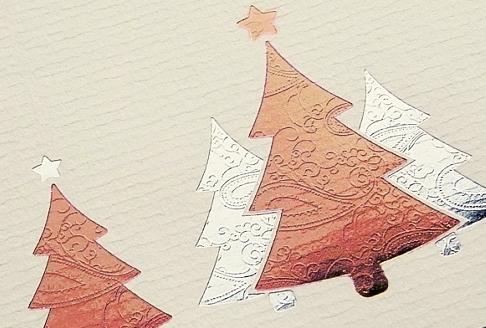 Spezielles Briefpapier mit gelaserten Elementen oder verschiedenfarbigen Heißfolien